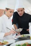 Futur cooking chef preparing dish Stock Photos