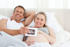 Futur parents looking at their x-ray Stock Photography