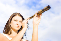Future. Portrait Of Young Woman With Telescope In An Image Depiction Of Hope Opportunity And Future Outlook, Copyspace In The Blue Cloudy Sky Background Stock Photo