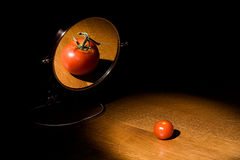 Future. A tomato looking in a mirror at it's future Royalty Free Stock Photos
