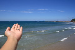 The future. A hand presenting the sea view Stock Photography