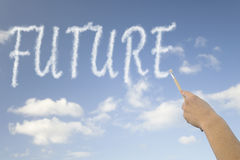 Future. The word future float in the blue sky surrounded by white clouds Stock Photos