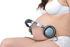 Future baby listens to music Stock Photo