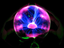 Future Ball. A fortune teller holds his hands on a plasma ball Stock Image