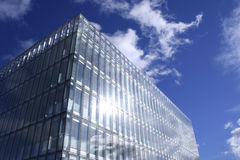 Future broadcast. Sunshine and clouds reflect of a new office building in Glasgow, Scotland royalty free stock photo