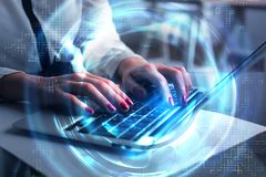 Future and business concept. Close up of businesswoman hands using laptop with glowing digital hologram at office desk. Future and business concept. Double Stock Image
