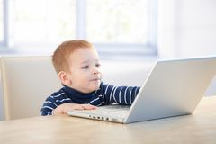 Future businessman using laptop at home Royalty Free Stock Photo