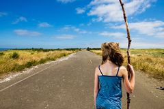 Future for a child. A young girl with a walking stick contemplating her future with long road ahead Stock Images