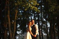 Future comes - sun illuminates faces of groom and bride. A royalty free stock photo