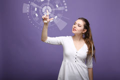 Future computer technology. Woman working with futuristic interface. Future computer technology. Woman in white dress working with futuristic interface on violet Royalty Free Stock Photo