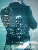 Future concept. Back view of young businessman on abstract city background. Future concept. Double exposure royalty free stock image