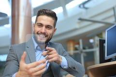 Future concept. Businessman holds futuristic transparent smart phone. Future concept. Businessman holds futuristic transparent smart phone royalty free stock photography