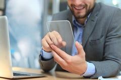 Future concept. Businessman holds futuristic transparent smart phone. Future concept. Businessman holds futuristic transparent smart phone stock images