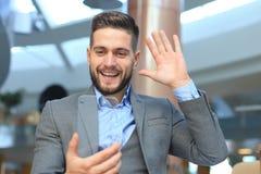 Future concept. Businessman holds futuristic transparent smart phone.  stock images