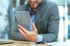Future concept. Businessman holds futuristic transparent smart phone.  stock photos