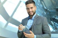 Future concept. Businessman holds futuristic transparent smart phone.  royalty free stock image