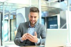 Future concept. Businessman holds futuristic transparent smart phone.  stock image