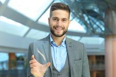 Future concept. Businessman holds futuristic transparent smart phone.  stock photo