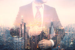 Future concept. Confident young businessman in suit and tie on creative city background. Double exposure. Future concept royalty free stock photos