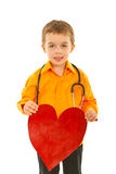 Future doctor boy holding heart Royalty Free Stock Photos
