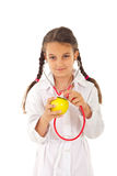 Future doctor girl checkup apple Royalty Free Stock Photo