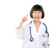 Future doctor. Holding syringe isolated on white background Royalty Free Stock Photos