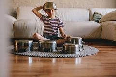 Future drummer boy with cooking pots at home royalty free stock photos