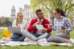 Future economists discussing their student life. Future economists. Future economists feeling involved in discussing their active student life while sitting on royalty free stock photography