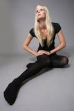 Future fashion model. Beautiful model posing on grey background Stock Photo