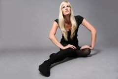 Future fashion model. Beautiful model posing on grey background Royalty Free Stock Photography