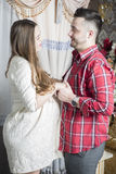 The future father gently touches the belly of his pregnant wife. Royalty Free Stock Photos