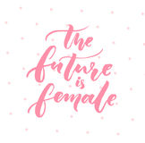 The future is female. Inspiration feminism quote, pink typography on white background with pink dots Stock Photography