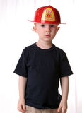 Future fireman redhead kid. Kid in a fireman dressup hat Royalty Free Stock Photos