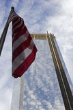 Future Freedom Tower in NYC. An American flag with a future Freedom Tower in the background royalty free stock photo