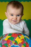 Future generation. Baby with planet showing Africa, looking at camera Stock Images