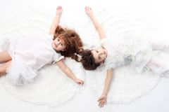 Future generation. Beautiful little angels. Isolated over white background Royalty Free Stock Photo