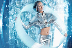Future girl. Beautiful young woman in silver latex costume with futuristic hairstyle and make-up. Sci-fi style Stock Photo