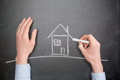 Future Home Owner Draws a House Royalty Free Stock Images