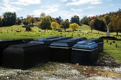 The future home of us all. Casket liners in front of a cemetery in West Virginia, sitting on top of gravel stock photos