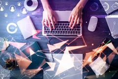 Future and innovation concept. Top view of hand using laptop with abstract digital hologram at office desktop with objects. Future and innovation concept. Double Stock Image