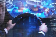 Future and innvation concept. Businessman driving car with digital business interface on abstract night city background. Future and innovation concept. Double Royalty Free Stock Image
