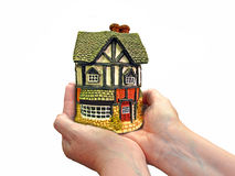 Future investment trust. Concept photo of future investment trust showing house property in the palm of hands Stock Image