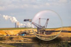 The future of lignite phase-out of coal-fired power generation. In a glassball stock photos