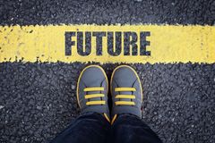 Step into the future. Future line child in sneakers standing next to a yellow line royalty free stock image