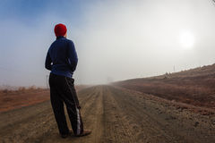 Teenager Mist Dirt Road Royalty Free Stock Photo