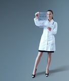Future of medicine. Sexy female doctor holding futuristic holographic sheet with medicine statistics report data. Medical / pharmaceutical research concept Stock Photography