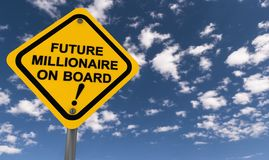 Future millionaire on board. A traffic sign with the text future millionaire on board Stock Photo