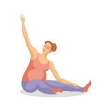 Future mother does exercises Royalty Free Stock Photo