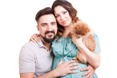 Future mother and father with their dog in studio photo stock images