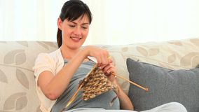 Future mother knitting stock video footage
